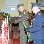Commandant John Martin Irish Defense Forces and Chief Superintendant  Michael Clancy lay wreaths