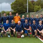 valedictory soccer match staff team with shield.